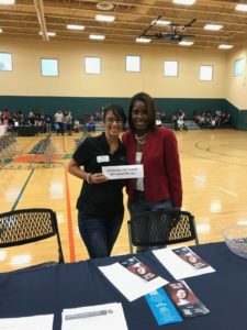 Advocate Maria at an outreach event.