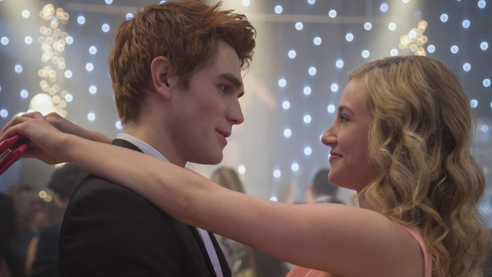Archie and Betty dancing together. Betty has her arms around Archie's shoulders